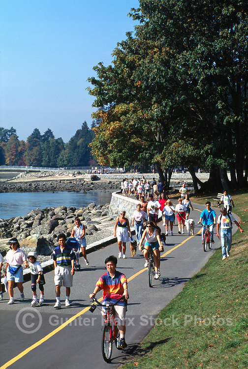 Stanley Park, Vancouver, BC, British Columbia, Canada - People cycling and walking on Seawall in Summer