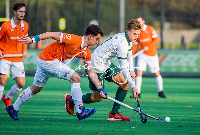BLOEMENDAAL - Thijs van Dam (R'dam) met Tim Swaen (Bldaal)  tijdens  hoofdklasse competitiewedstrijd  heren , Bloemendaal-Rotterdam (1-1) .COPYRIGHT KOEN SUYK