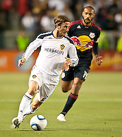 CARSON, CA – May 7, 2011: LA Galaxy midfielder David Beckham (23) moves the ball upfield during the match between LA Galaxy and New York Red Bull at the Home Depot Center, May 7, 2011 in Carson, California. Final score LA Galaxy 1, New York Red Bull 1.