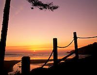 Rope fence and setting sun. Near Newport, Oregon