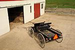 Nippenose Valley. Amish buck board and barn doors.