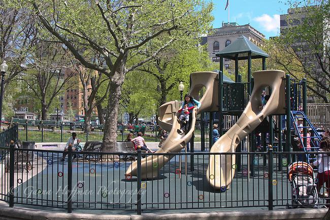 People enjoying public playground. Boston Common, MA
