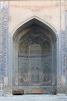 "Detail of niche in courtyard, Sher-Dor Madrasah, 1619-36, Registan, Samarkand, Uzbekistan, pictured on July 15, 2010, in the afternoon. The Sher-Dor Madrasah, commissioned by Yalangtush Bakhodur as part of the Registan ensemble, and designed by Abdujabor, takes its name, ""Having Tigers"", from the double mosaic (restored in the 20th century) on the tympans of the portal arch showing suns and tigers attacking deer. Samarkand, a city on the Silk Road, founded as Afrosiab in the 7th century BC, is a meeting point for the world's cultures. Its most important development was in the Timurid period, 14th to 15th centuries. Picture by Manuel Cohen."