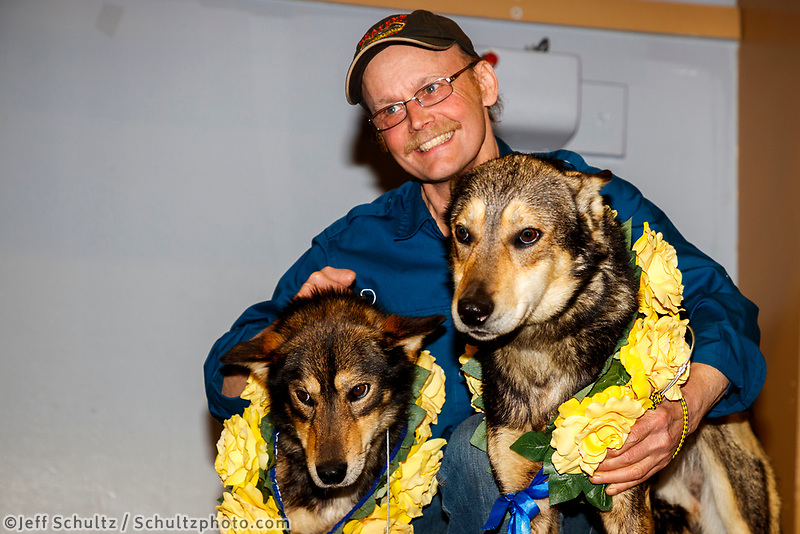 First place winner Mitch Seavey poses with his lead dogs Crisp and Pilot at the musher awards ceremony  in Nome during the 2017 Iditarod on Sunday March 19, 2017.<br /> <br /> Photo by Jeff Schultz/SchultzPhoto.com  (C) 2017  ALL RIGHTS RESERVED