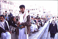 Yemen Sana'a,.men , traditional dressed an with their Jambiya, sitted and talking in the big quare