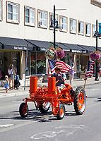Orange Tractor with American Flags, Auburn Days Parade 2016, Auburn, WA, USA.