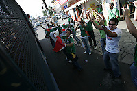 Mexican fans cheer and chant at United States fans who were placed on a Mexican police transport bus leaving Azteca Stadium under a police escort. Mexican police officers in riot gear separated the team's fan supporters to prevent any violence and fearing for the fan's safety, Mexican police transported the United States fans to a different subway stop to travel back to their hotels. The United States Men's National Team played Mexico in a CONCACAF World Cup Qualifier match at Azteca Stadium in, Mexico City, Mexico on Wednesday, August 12, 2009.