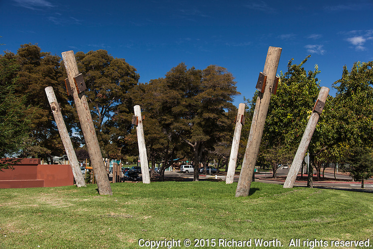 Massive wooden posts that held a work of wooden art that succumbed to decay, stand ready for their next installation.  Urban art, public art.