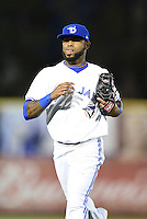 Dunedin Blue Jays shortstop Jose Reyes (7) - on rehab assignment from the Toronto Blue Jays -  jogs off the field during a game against the Daytona Cubs on April 16, 2014 at Florida Auto Exchange Stadium in Dunedin, Florida.  Dunedin defeated Daytona 5-1.  (Mike Janes/Four Seam Images)