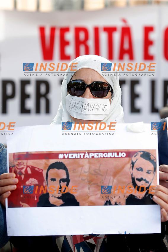 Donna imbavagliata con un cartello Verita' per Giulio Regeni<br /> Roma 02-05-2016 Maratona di sit-in davanti alle ambasciate dell'Iran, dell'Egitto e della Turchia organizzata da Articolo 21, FNSI, UsigRai, RSF Italia, Amnesty International Italia, Pressing NoBavaglio, per libert&agrave;' di stampa e diritti umani.<br /> Marathon of sit-ins in front of the Iranian, Egyptian and Turkish embassies for freedom of the press and for human rights.<br /> Photo Samantha Zucchi Insidefoto