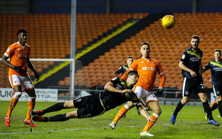 Shrewsbury Town's Mat Sadler heads to safety with Blackpool's John O'Sullivan lurking<br /> <br /> Photographer Alex Dodd/CameraSport<br /> <br /> The EFL Sky Bet League One - Blackpool v Shrewsbury Town - Saturday 19 January 2019 - Bloomfield Road - Blackpool<br /> <br /> World Copyright © 2019 CameraSport. All rights reserved. 43 Linden Ave. Countesthorpe. Leicester. England. LE8 5PG - Tel: +44 (0) 116 277 4147 - admin@camerasport.com - www.camerasport.com