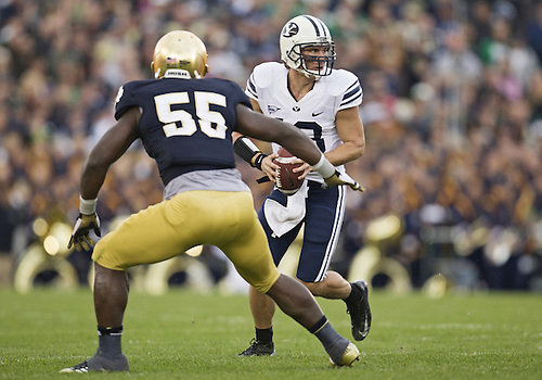 October 20, 2012:  BYU quarterback Riley Nelson (13) rolls out of the pocket during NCAA Football game action between the Notre Dame Fighting Irish and the BYU Cougars at Notre Dame Stadium in South Bend, Indiana.  Notre Dame defeated BYU 17-14.