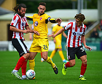 Lincoln City's Michael Bostwick and Lincoln City's Alex Woodyard vies for possession with Morecambe's Michael Rose<br /> <br /> Photographer Andrew Vaughan/CameraSport<br /> <br /> The EFL Sky Bet League Two - Lincoln City v Morecambe - Saturday August 12th 2017 - Sincil Bank - Lincoln<br /> <br /> World Copyright &copy; 2017 CameraSport. All rights reserved. 43 Linden Ave. Countesthorpe. Leicester. England. LE8 5PG - Tel: +44 (0) 116 277 4147 - admin@camerasport.com - www.camerasport.com