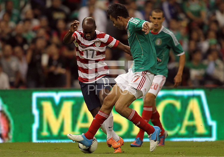 MEXICO CITY, MEXICO - AUGUST 15, 2012:  DaMarcus Beasley (17) of the USA MNT battles for the ball with Jesus Zavala (17) of  Mexico during an international friendly match at Azteca Stadium, in Mexico City, Mexico on August 15. USA won 1-0.