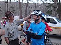 NWA Democrat-Gazette/FLIP PUTTHOFF <br /> Tim Scott, assistant superintendent at Devil's Den State Park, chats with a rider April 1, 2016 before a group ride during the Ozark Mountain Bike Festival.