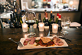 USA, Oregon, Willamette Valley, pork served three ways and a view of the kitchen at Nick's Italian Cafe in McMinville