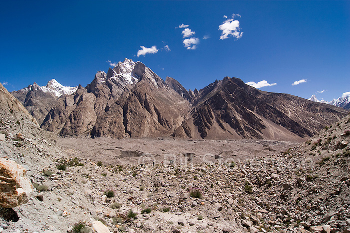 The terminus of the Biafo Glacier below snow capped mountains in the Karakoram Himalaya of Pakistan