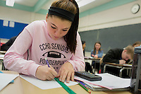 Senior students work on math problems in Sandra Haupt's Intro to Calc class at Concord-Carlisle Regional High School in Concord, MA, USA. The class has partnered with MIT Blossoms to use video education tools in conjunction with regular lessons to reinforce key concepts.