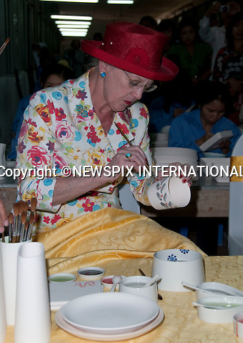 "CROWN PRINCESS MARY AND QUEEN MARGRETHE.Queen Margrethe should that she is a deft hand at painting while visiting Phomex a Ceramics Factory in Ba Trang, Hanoi. The Queen painted several ceramics pieces named after her grandchildren. Not to be out done Crown Princess Mary painted a ceramic plate and vase_3/11/2009.Mandatory Photo Credit: ©Dias/Newspix International..**ALL FEES PAYABLE TO: ""NEWSPIX INTERNATIONAL""**..PHOTO CREDIT MANDATORY!!: NEWSPIX INTERNATIONAL(Failure to credit will incur a surcharge of 100% of reproduction fees)..IMMEDIATE CONFIRMATION OF USAGE REQUIRED:.Newspix International, 31 Chinnery Hill, Bishop's Stortford, ENGLAND CM23 3PS.Tel:+441279 324672  ; Fax: +441279656877.Mobile:  0777568 1153.e-mail: info@newspixinternational.co.uk"