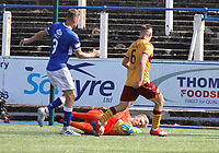 Robby McCrorie dives at the feet of Allan Campbell to save in the SPFL Betfred League Cup group match between Queen of the South and Motherwell at Palmerston Park, Dumfries on 13.7.19.