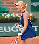 Kristina Mladenovic (FRA) defeats Na Li (CHN) at  Roland Garros being played at Stade Roland Garros in Paris, France on May 27, 2014