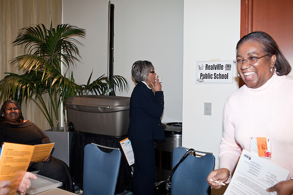"""March 11, 2010. Raleigh, North Carolina.. The first N.C. Poverty Simulation Experience training session was held at the 40th Annual State Head Start Conference at the Raleigh Convention Center.  . Nearly 60 individuals, including staff and parents from Head Start programs and Community Action Agencies, engaged in role playing exercises that hoped to simulate the experience of being poor and what the poor go through on a daily basis.. A """"child"""" smokes at """"school""""."""