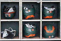 Miami Hurricanes helmet rack on June 20, 2016 at TD Ameritrade Park in Omaha, Nebraska. (Andrew Woolley/Four Seam Images)