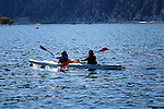 Two kayakers take a leisure paddle on Lake Chelan in the Fall.