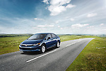 One blue 2012 Honda Civic Sedan DX driving on country road.