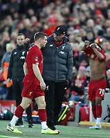 5th January 2020; Anfield, Liverpool, Merseyside, England; English FA Cup Football, Liverpool versus Everton; Liverpool manager Jurgen Klopp speaks with James Milner   after his early substitution through injury - Strictly Editorial Use Only. No use with unauthorized audio, video, data, fixture lists, club/league logos or 'live' services. Online in-match use limited to 120 images, no video emulation. No use in betting, games or single club/league/player publications