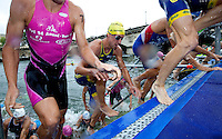 09 JUL 2011 - PARIS, FRA - Competitors scramble up the steps at the end of the swim during the men's French Grand Prix series race (PHOTO (C) NIGEL FARROW)