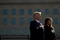 United States President Donald J. Trump, left, and first lady Melania Trump pause during a ceremony to commemorate the September 11, 2001 terrorist attacks, at the Pentagon in Washington, D.C., U.S., on Monday, Sept. 11, 2017. Trump is presiding over his first 9/11 commemoration on the 16th anniversary of the terrorist attacks that killed nearly 3,000 people when hijackers flew commercial airplanes into New York's World Trade Center, the Pentagon and a field near Shanksville, Pennsylvania. <br /> CAP/MPI/CNP/RS<br /> &copy;RS/CNP/MPI/Capital Pictures