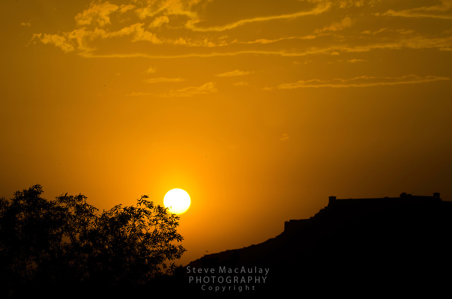 Hari Parbat Fort in silhouette at sunset, Srinagar, Kashmir, India.