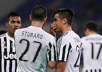 Calcio, Serie A: Lazio vs Juventus. Roma, stadio Olimpico, 4 dicembre 2015.<br /> Juventus&rsquo; Paulo Dybala, right, talks to teammate Stefano Sturaro after scoring during the Italian Serie A football match between Lazio and Juventus at Rome's Olympic stadium, 4 December 2015.<br /> UPDATE IMAGES PRESS/Isabella Bonotto