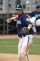 July 1, 2007: Third baseman Matt Mangini of the Everett AquaSox throws the ball across the diamond during a Northwest League game at Everett Memorial Stadium in Everett, Washington.