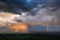 Rain shower with rainbow at sunset, Pueblo County, Colorado.  May 28, 2015