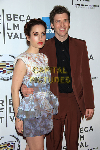 "Zoe Lister-Jones and Daryl Wein.The 2012 Tribeca Film Festival World Premiere of ""Lola Versus"" at the Tribeca Performing Arts Center, New York, NY, USA..April 24th, 2012.half length dress peplum blue white arm around waist beige print black shirt brown suit.CAP/LNC/TOM.©LNC/Capital Pictures."