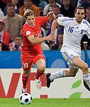 Roman Pavlyuchenko and Sotirios Kyrgiakos at Euro 2008, RUS-GRE, 06142008, Salzburg, Austria