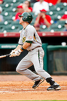 Landis Ware #5 of the Baylor Bears follows through on his swing against the Houston Cougars at Minute Maid Park on March 4, 2011 in Houston, Texas.  Photo by Brian Westerholt / Four Seam Images