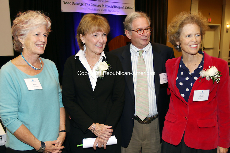 WATERBURY CT. 20 November 2015-112015SV04-From left, Molly Baldrige, Chris Black author, B. Jay Cooper, author, and Megan Baldrige attend A Book Launch Celebration for the release of &quot;Mac Baldrige: The Cowboy in Ronald Reagan's Cabinet,&quot; by Black and Cooper in Waterbury Friday. The event was co-sponsored by the Post University Malcolm Baldrige School of Business and the Waterbury Chamber.<br /> Steven Valenti Republican-American