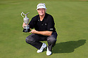 SOUTHPORT, ENGLAND - JULY 29:  Mark Wiebe of the United States poses with the trophy after winning the play-off against Bernhard Langer of Germany after the final round of The Senior Open Championship played at Royal Birkdale Golf Club on July 29, 2013 in Southport, United Kingdom.  (Photo by Phil Inglis/Getty Images)