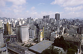 Sao Paulo, Brazil. High view with inner ring road with flyovers and Banespa bank building with helipad.