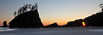The setting sun bursts through the arch at Second Beach, Olympic National Park, WA