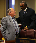 Former Nevada Assemblyman Bernie Anderson, left, talks with Assemblyman Harvey Munford, D-North Las Vegas, on the Assembly floor at the Legislative Building in Carson City, Nev. on Thursday, Feb. 7, 2013. .Photo by Cathleen Allison
