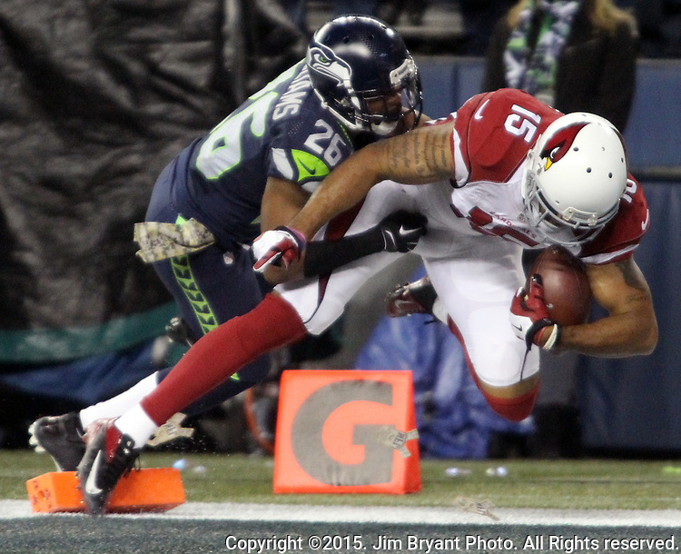 Arizona Cardinals wide receiver Michael Floyd (15) scores on a 27 yard touchdown pass over defending Seattle Seahawks cornerback Cary Williams (26) at CenturyLink Field in Seattle, Washington on November 15, 2015. The Cardinals beat the Seahawks 39-32.   ©2015. Jim Bryant photo. All Rights Reserved.