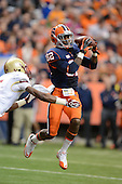 Syracuse Orange wide receiver Alvin Cornelius (82) brings in a pass before it gets knocked out by Boston College Eagles defensive back Al Louis-Jean, Jr. (5) during a game at the Carrier Dome on November 30, 2013 in Syracuse, New York.  Syracuse defeated Boston College 34-31.  (Copyright Mike Janes Photography)