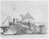 RGS K-27 #461 with Dallas Divide snow on her plow and caboose #0400 in tow at the Ridgway depot.  Tender has Sunrise lettering.<br /> RGS  Ridgway, CO  Taken by Richardson, Robert W. - 11/20/1951