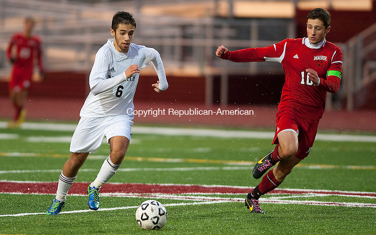 NAUGATUCK- 110713JS03- Naugatuck's Diogo Cruz (6) looks to slip past Masuk's Joe Vergato (10) during their game Thursday at Naugatuck High School. <br /> Jim Shannon Republican-American