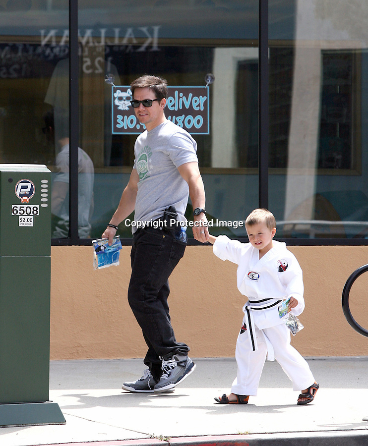 7-10-2010..Mark Wahlberg took his son Brendan Joseph to a toy store after picking him up form Karate class in Los Angeles ..AbilityFilms@yahoo.com.805-427-3519.3273.www.AbilityFilms.com