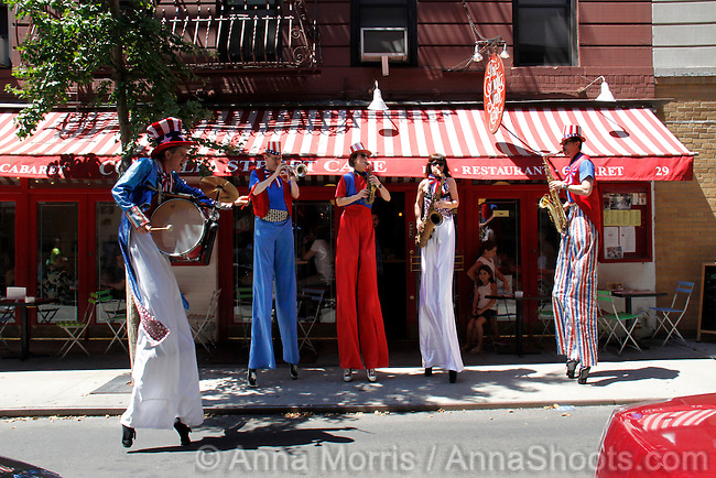 "The Cornelia Street Cafe celebrates the anniversary of its founding every year on July 4th .  This year was its 33rd ""birthday"" and to set the tone, The Shinbone Alley Stilt Band played for them, their gursts and passers by - in a 95 F degree New York summer heat wave!  http://www.bondst.org/activities/?c=Stilt-Band"